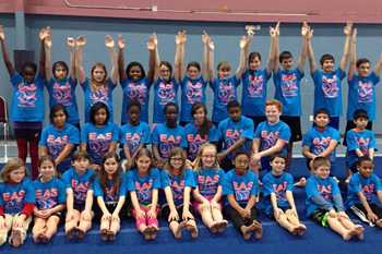 Crusader gymnastics team sporting our new T-shirts for the MPA Acro Clinic.